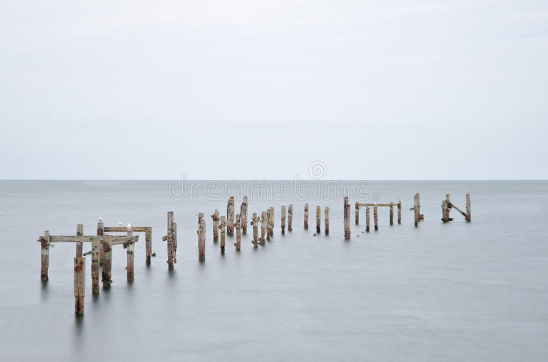 Long Exposure Derelict Pier In Calm Sea Royalty Free Stock Photo