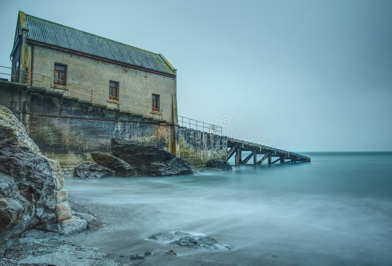 Long exposure. Disused lifeboat station at Polpeor Cove, Lizard Point, Cornwall. Long exposure photo of the old lifeboat station at the Lizard, Cornwall. Built royalty free stock image