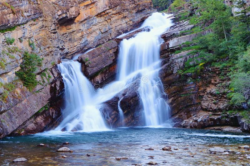 Beautiful Cameron Falls in Evening Light, Waterton Lakes National Park, Alberta, Canada. Long exposure of the double cascades of Cameron Falls in the Canadian royalty free stock images