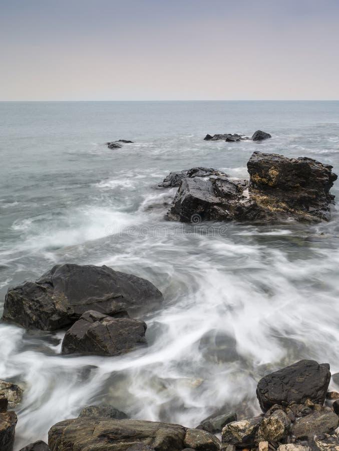 Long exposure flowing tide over rocks