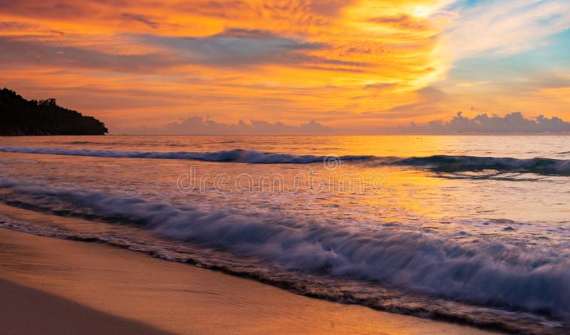 Long exposure horizontal photo in the beach of waves and dramatic sky during sunset in Borneo. Island, Malaysia stock photos