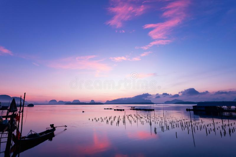Long exposure image of Dramatic color sky seascape with reflection in sunset or sunrise scenery nature for background. stock photos
