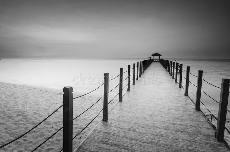 Long exposure image of old abandoned fisherman jetty in black an stock image