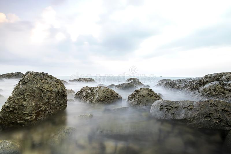 Long exposure image on stone and sunset landscape fo andaman sea royalty free stock photos