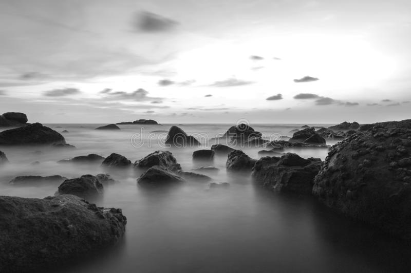 Long exposure image on stone and sunset landscape fo andaman sea royalty free stock photo