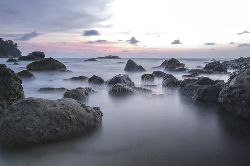 Long exposure image on stone and sunset landscape fo andaman sea stock photos