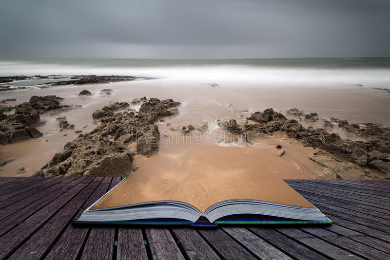 Long exposure landscape beach scene with moody sky Creative concept royalty free stock photo