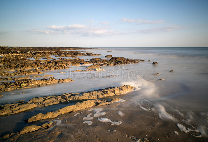 Download Long Exposure Landscape Rocky Shoreline At Sunset Stock Image - Image: 31400337