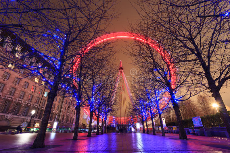 Long exposure of London Eye with red light stock photo