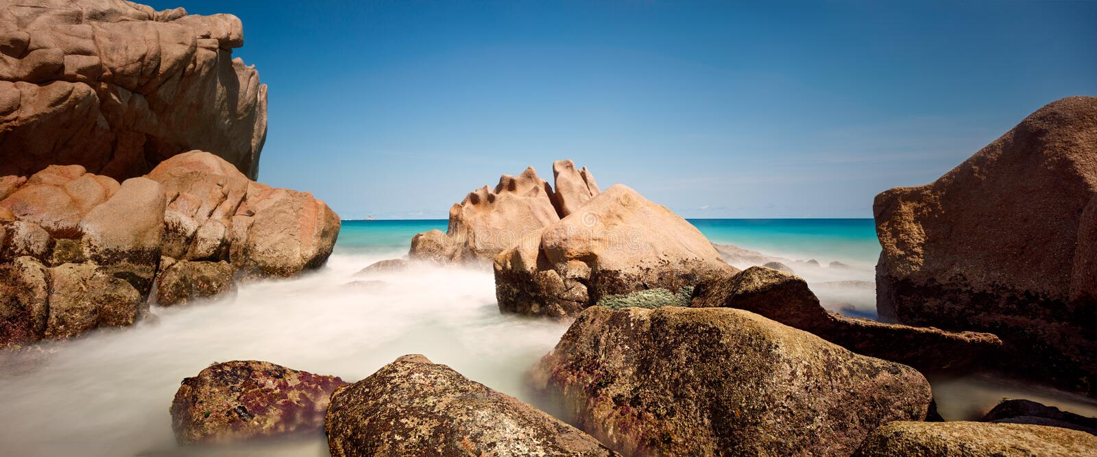Long exposure of misty sea and rocks stock photos