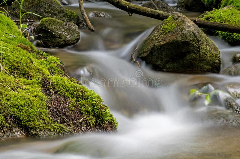 Long Exposure Of A Moss Covered Woodland Stream royalty free stock image