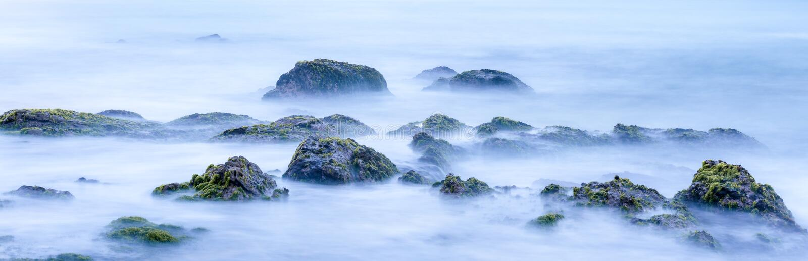 Long exposure of mystery ocean and rocks royalty free stock photos