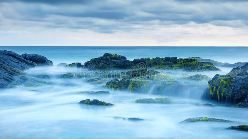 Long exposure of mystery ocean and rocks stock images