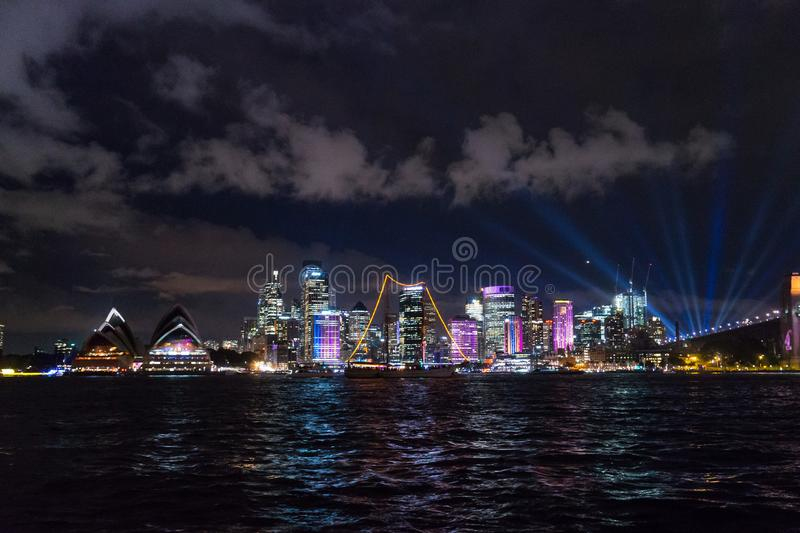 Long exposure night shot of the city center of the Sydney skyline looking over the opera house during vivid stock image