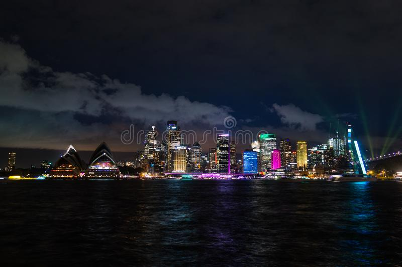 Long exposure night shot of the city center of the Sydney skyline looking over the opera house during vivid stock photo