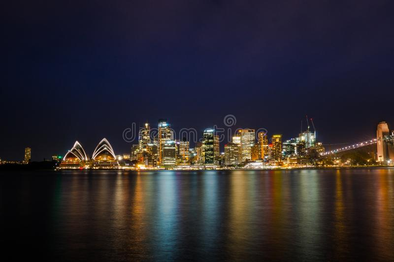 Long exposure night shot of city center of Sydney skyline looking over the harbor stock photos