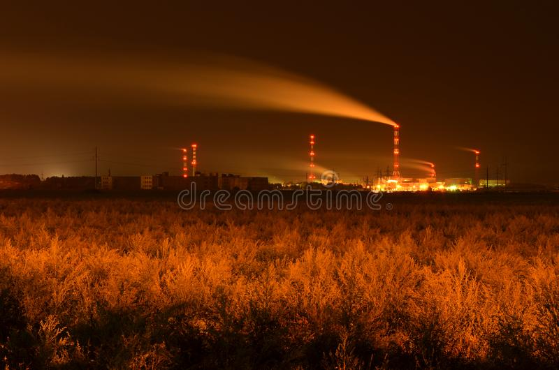 Long exposure night shot of working chemical plant. royalty free stock image