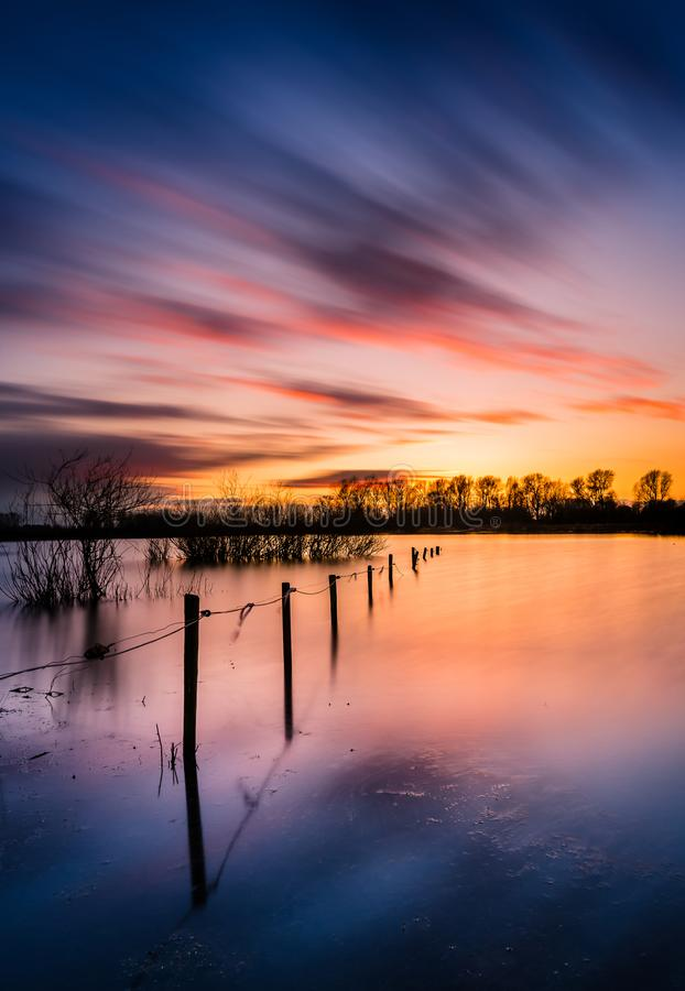 Free Long Exposure Of Sunset With Row Poles Stock Photography - 113097132