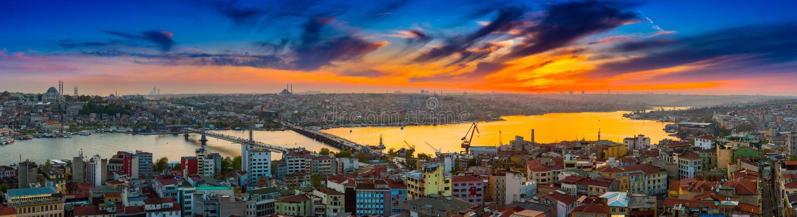 Long exposure panoramic cityscape of Istanbul at a beautiful dramatic clouds sunset from Galata to Golden Horn gulf. View stock photos