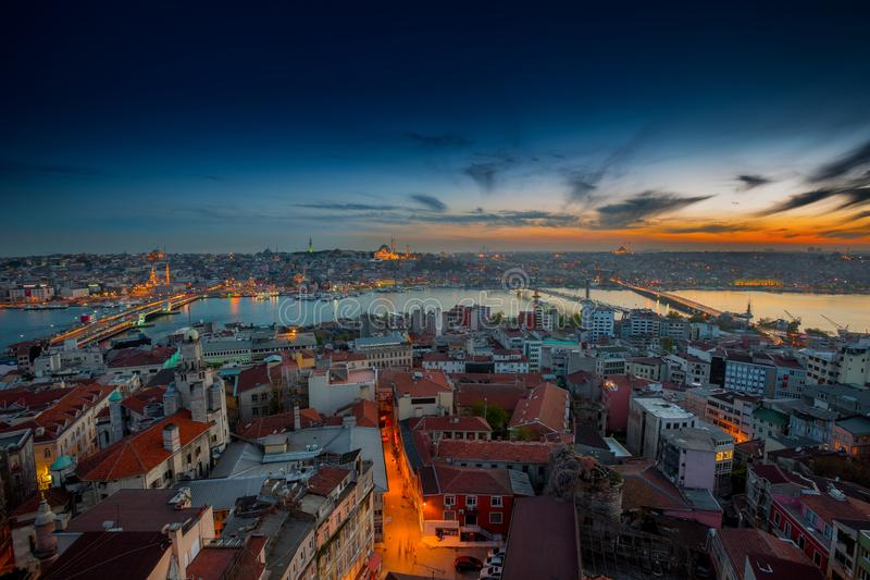 Long exposure panoramic cityscape of Istanbul at a beautiful dramatic clouds sunset from Galata to Golden Horn gulf. View royalty free stock photos
