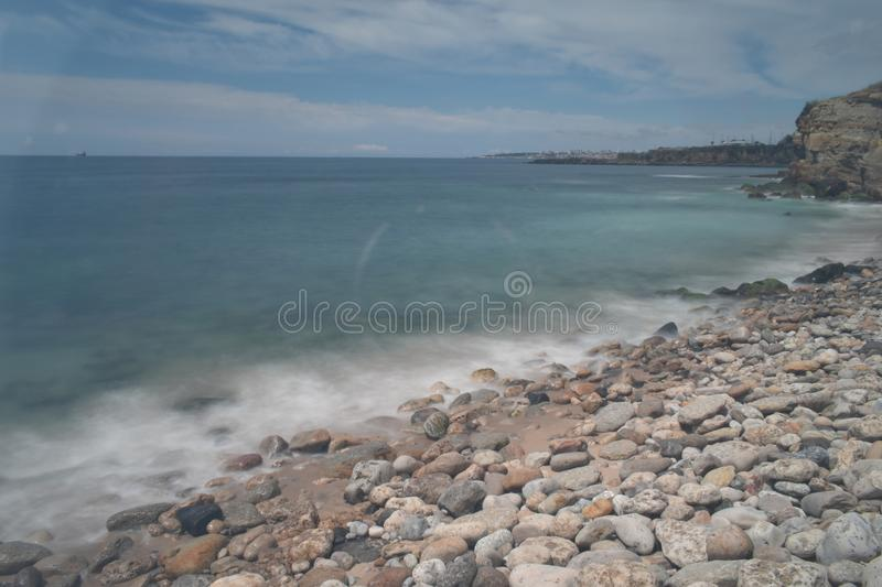 Rocks water sea long exposure day royalty free stock photography