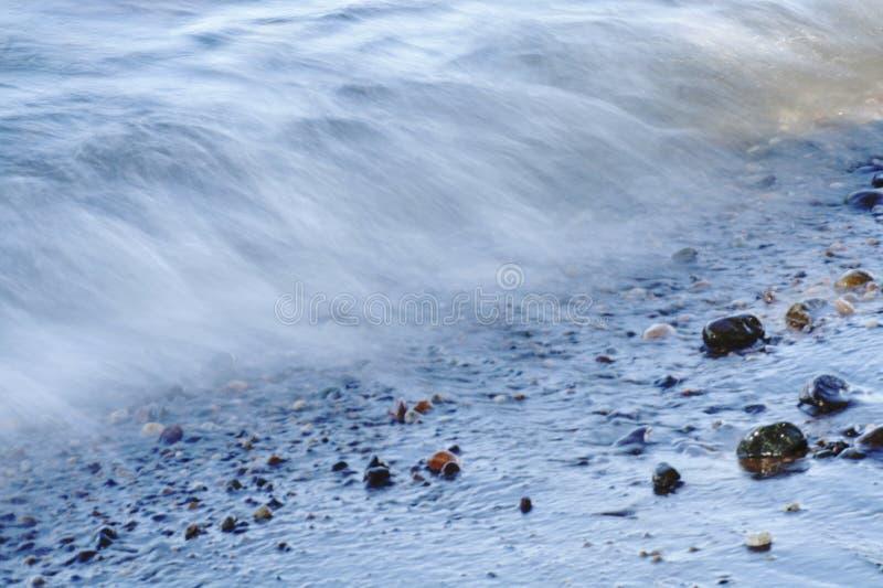 Long exposure photo of breaking waves. Long exposure photo breaking waves stock photo
