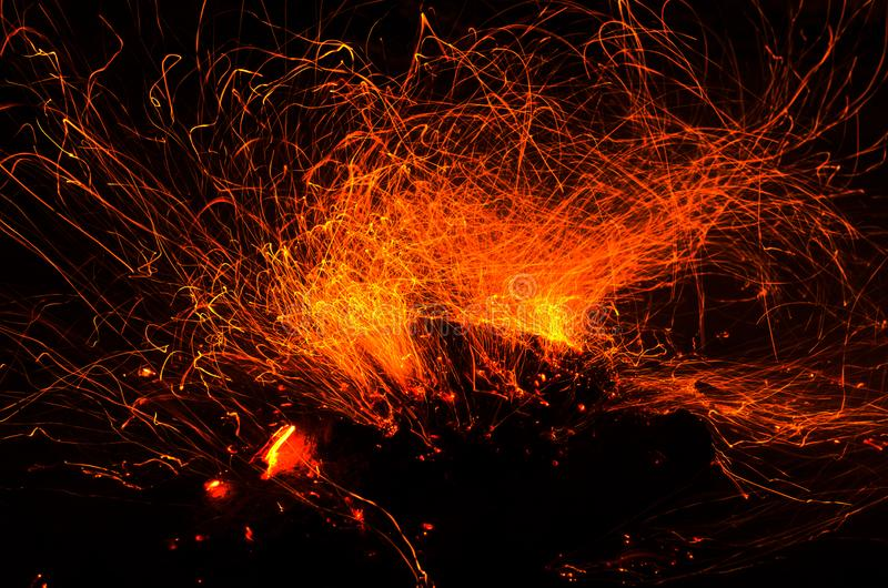 Long exposure photo of fire sparkles stock photos