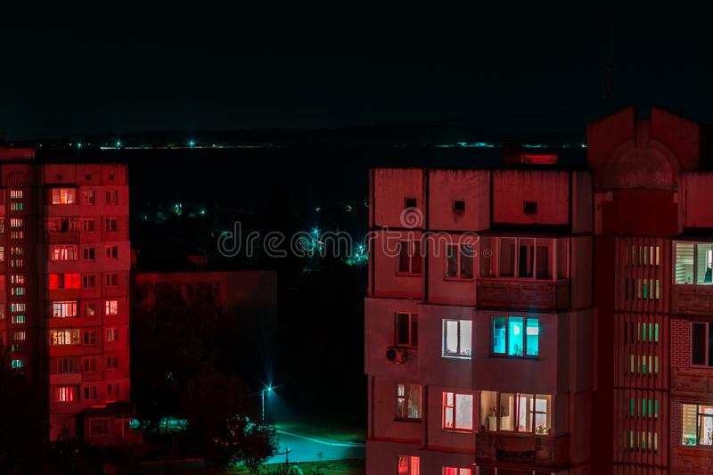 Long exposure photo of high-rise buildings in red and blue lights. Night cityscape. Big city life.  royalty free stock image