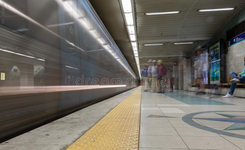 Long exposure photo of moving metro in rossio Lisbon royalty free stock images