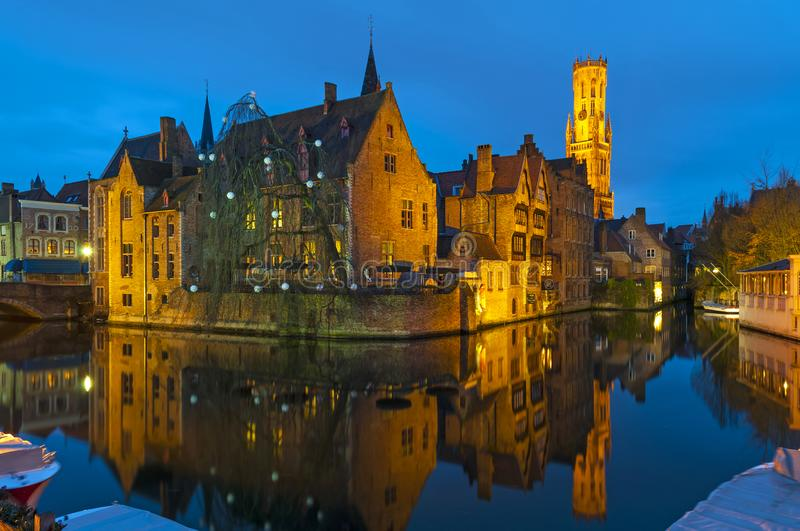 Medieval Bruges Canals at Night, Belgium. Long exposure photograph of the canals in Bruges by the Rozenhoedkaai during the blue hour with the illuminated belfry stock photography