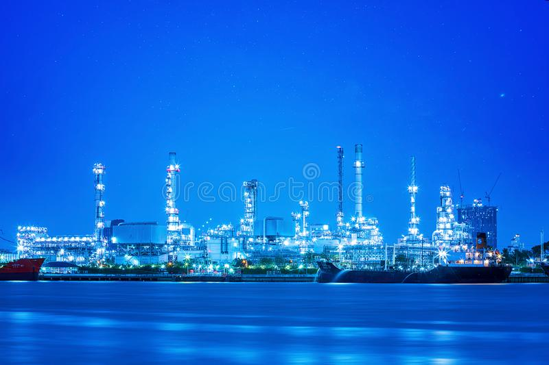Long exposure photograph with grain. Star at Bangchak Refinery. Banchak Oil Refinery, beside the Chao Phraya River, Water royalty free stock photo