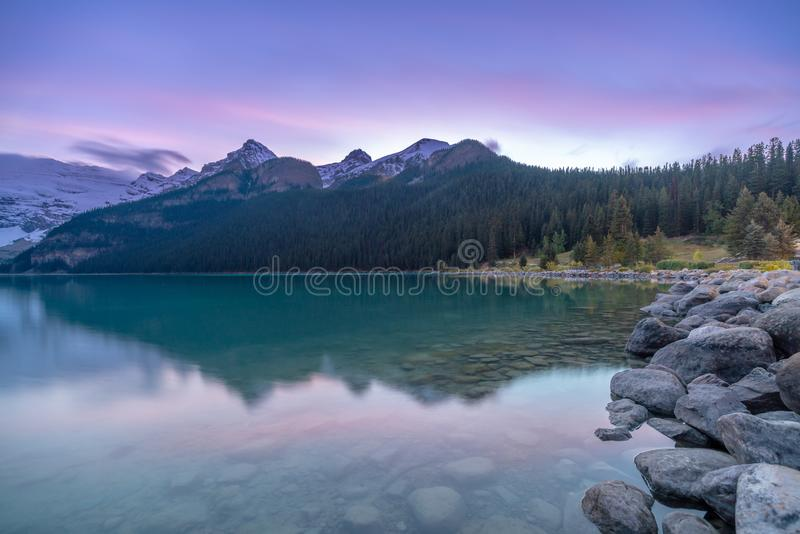 Long exposure photography of purple blue sky during dusk at Lake Louise. Alberat, Canada stock photos