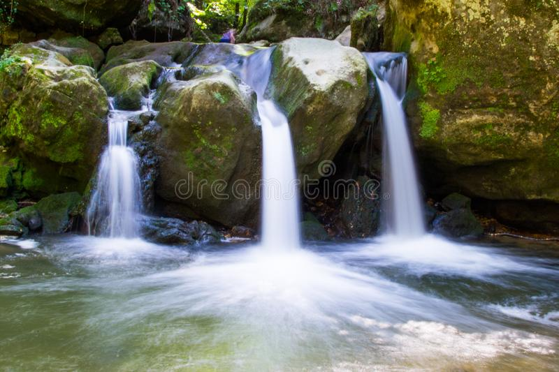 Long exposure picture of Schiessentümpel or Schéissendëmpel Waterfall in Mullerthal, Luxembourg.  stock images