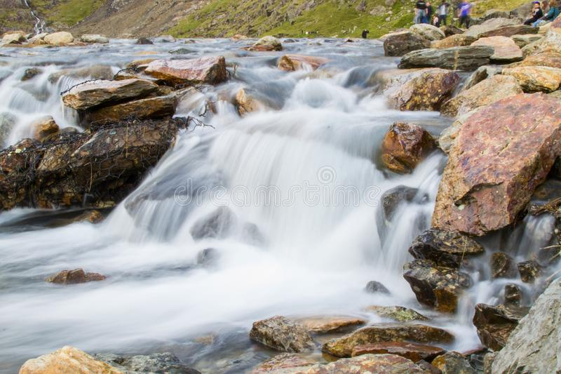 Long exposure picture of a small cold waterfalls through boulders in Snowdonia, Wales.  stock image