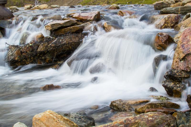 Long exposure picture of small waterfalls between boulders making a brook in Snowdonia, Wales.  royalty free stock photography
