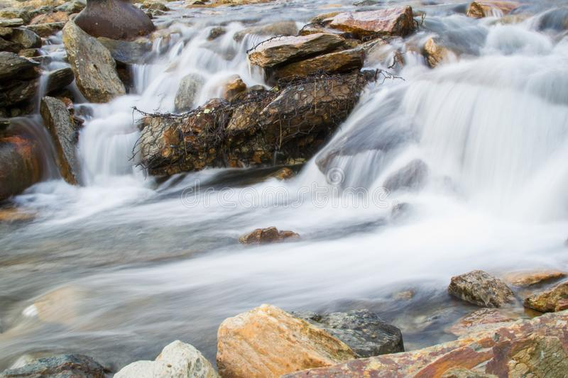 Long exposure picture of small waterfalls between boulders making a brook in Snowdonia, Wales.  stock photography