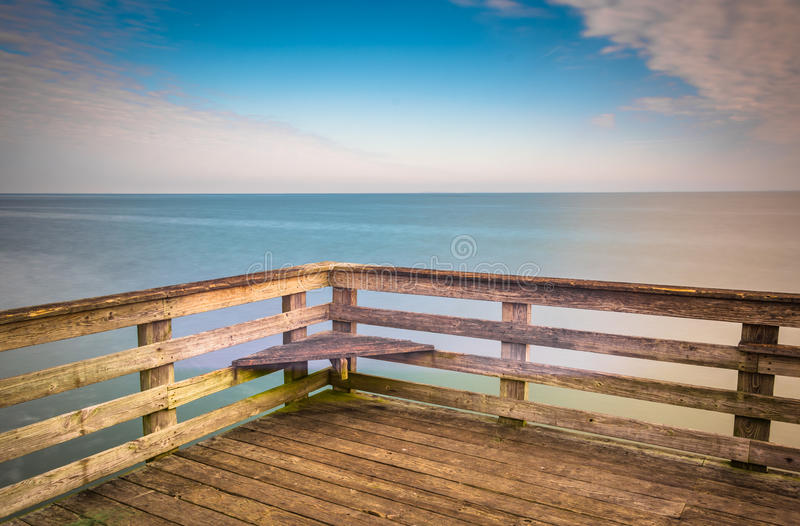 Long exposure a pier and the Chesapeake Bay in Chesapeake Beach, Maryland. Long exposure a pier and the Chesapeake Bay in Chesapeake Beach, Maryland royalty free stock images