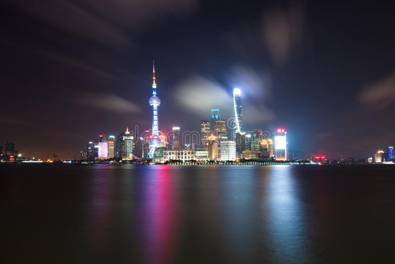 Long exposure of Pudong district, modern skyscrapers, Huangpu river in Shanghai at night. Cityscape and urban architecture. Long exposure of Pudong district royalty free stock images