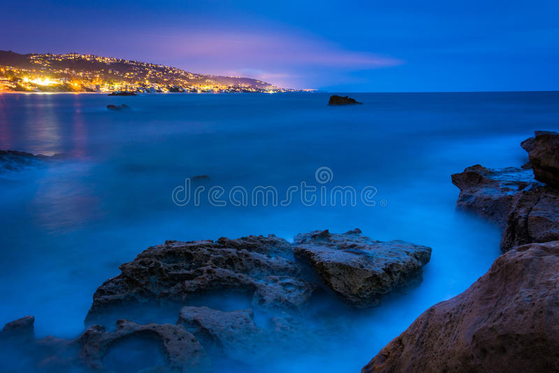 Long exposure of rocks and waves in the Pacific Ocean at twilight, at Monument Point, Heisler Park, Laguna Beach, California. stock photo