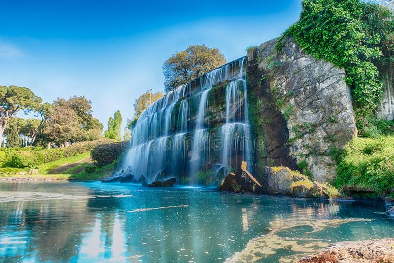 Scenic waterfall in the EUR district of Rome, Italy. Long exposure with the scenic waterfall in the big fountain of EUR artificial lake, modern district in the stock image