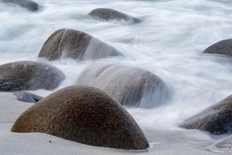 Long exposure of sea and stones on the beach. Long exposure of sea and stones on the Utakleiv beach, Lofoten islands, Norway royalty free stock photography