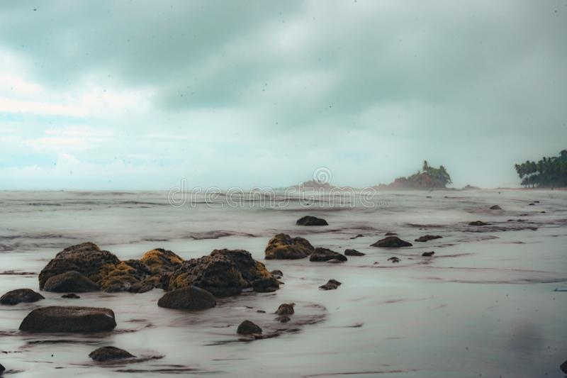 Long exposure of sea water on the beach royalty free stock image