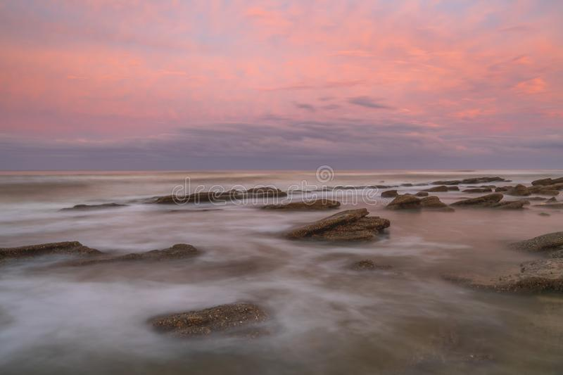 Long exposure seascape of a painterly sunset on a Florida beach. royalty free stock photo