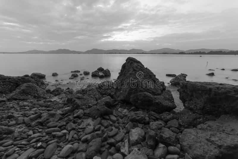 Long exposure of seascape scenery with rocks in black and white,beautiful image can be used nature composition for background and stock photo