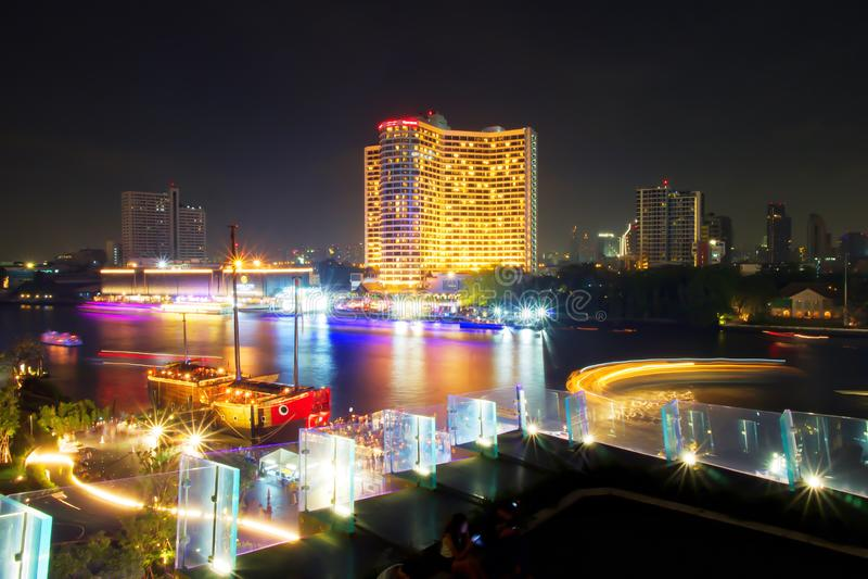 Long exposure of Ship/Boat sailing in Chao Phraya River, Bangkok, Thailand. Lighting from transportation. Beautiful of light trail. Long exposure of Ship or Boat royalty free stock photo