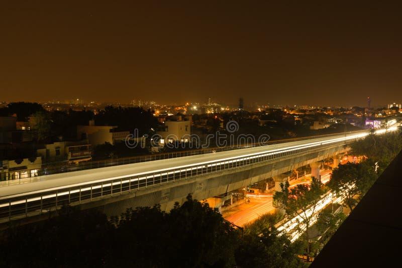 Long exposure shot of Bengaluru Metro train moving on the bridge new Mysore road Bengaluru, India.  royalty free stock images