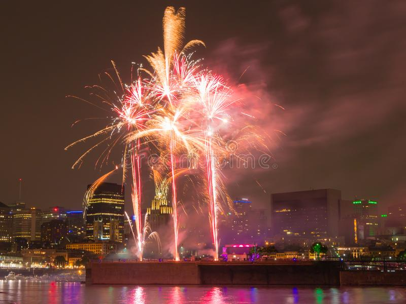 Long exposure shot of colorful fireworks in the old port of Montreal for the celebration of Canada day. Montreal, Quebec, Canada royalty free stock photo
