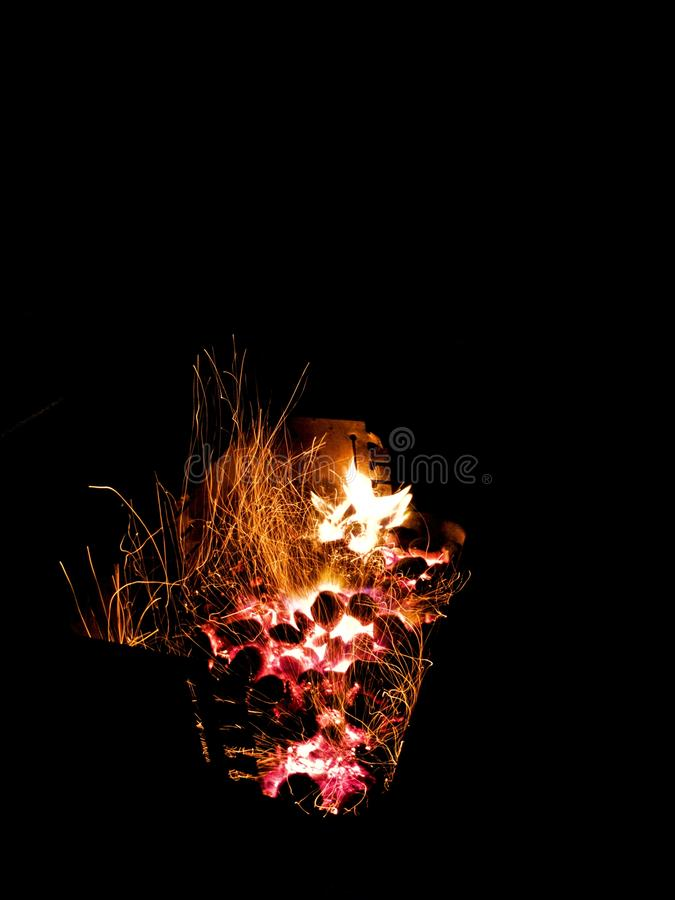 Long Exposure Shot of Fire Sparks. In A Barbecue royalty free stock photos