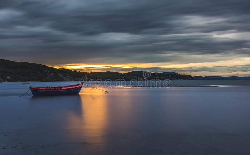 Long exposure shot of an isolated boat at sunset. Greece royalty free stock images