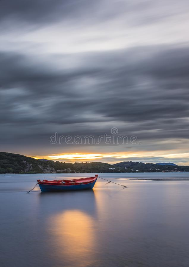 Long exposure shot of an isolated boat at sunset. Greece stock photos